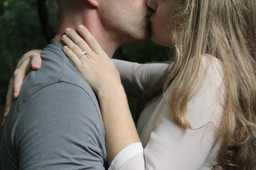 couple intimately kissing